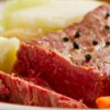 Corned beef with vegetables & white onion sauce.
